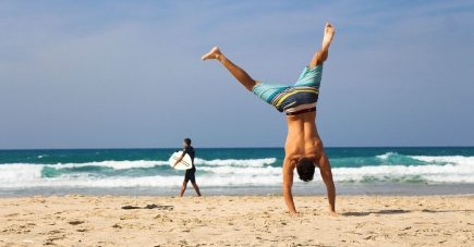 fulfilling dream of early retirement and doing cartwheels on a beach